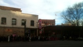 American flag waving over the weird circus line at VooDoo Donuts